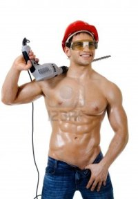 1 11391351-the-beauty-muscular-worker-driller-man--hold-big-perforator-in-hand-and-smile-vertical-photo-on-whit