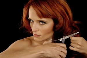 1 life123.com bigstockphoto_woman_cutting_hair_5009322_s600x600